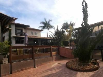 Casa em condomínio de 412,00m²,  à venda