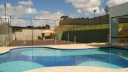 Espaço gourmet com piscina , salão de festa e quadras